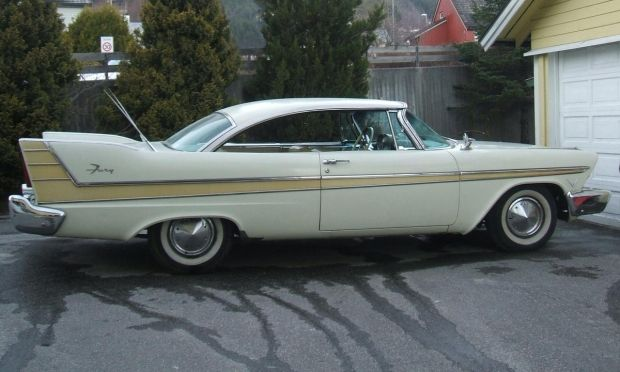1957 Plymouth Fury ~ Dad bought one at an auction ... Light green in color, it had a push button radio! Oh ... and no seat belts.