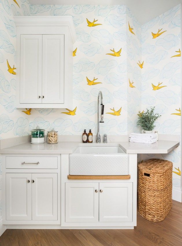 Tweet tweet, this laundry room is soaring! Two Peas and Their Pod created a fun, family-friendly laundry room with room to spread their wings! Designer: The Fox Group Caesarstone Statuario Nuvo countertop