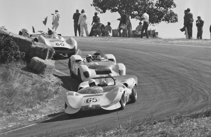 Laguna Seca 200 miles, October 17, 1965. Heat two. Hap Sharp leads Charlie Hayes a McLaren Elva-Oldsmobile and Don Wester's Genie-Ford through the Corkscrew at Laguna Seca. Jim Hall had wrecked his car in Heat one. Sharp would finish 2nd to Walt Hansgen's Lola T70 in both heats. Duke Manor photo.