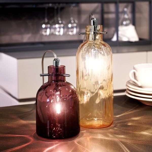 The Bossa Nova table lamp is an eternally chic design from Italian lighting producer, Selene Illuminazione. The blown glass bottle comes in clear, smoked, amber and amethyst glass.