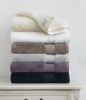 Towels. tip on towel care: Add half a cup of bi carb to the wash, then a cup of vinegar to the rinse cycle. Vinegar softens hard water, reduces lint and increases the absorbency of the towel. Note: Do not use fabric softener on towels, it will reduce the absorbency of the towel as it coats the towel. Drying your towels in the sun will sanitise them.