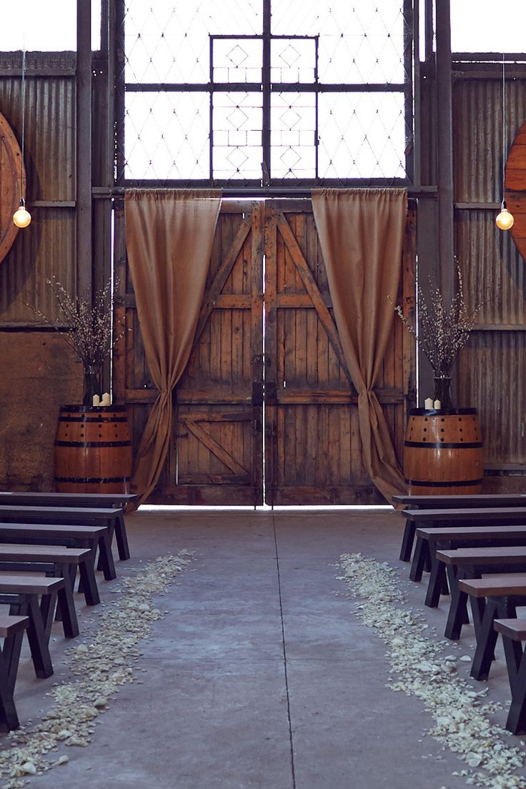 Rustic barn wedding ceremony styling | Lost in Love Photography | See more: http://theweddingplaybook.com/winter-barn-wedding/