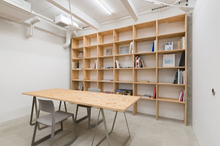 Japanese studio Sides Core has created a space inside a hair salon for the owner's books, art and music