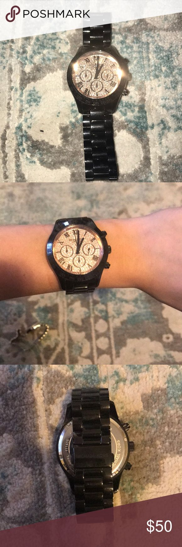 Black Michael Kors watch w Rose Gold Diamond Face Black Michael Kors watch with Rose Gold Diamond Face! Perfect condition. I do have a small wrist but there is wiggle room. If interested I will try to provide better/ exact measurements of my wrist. KORS Michael Kors Accessories Watches