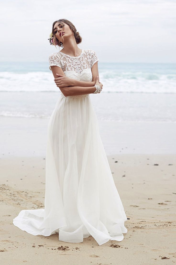 Scarlet wedding dress, Anna Campbell. Dreamy tulle skirt with capped-sleeve lace overlay. #wedding #dress