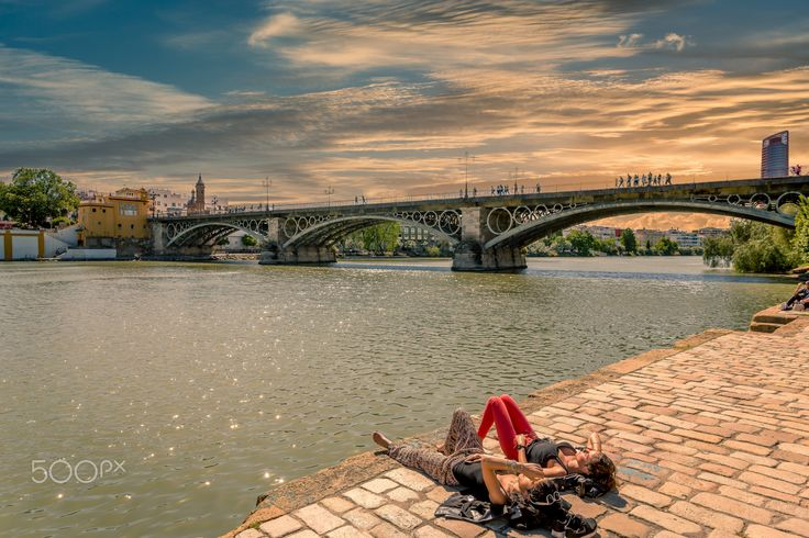 Last Rays of Sun - Exposure at sunset of the Triana Bridge in Seville, Spain.