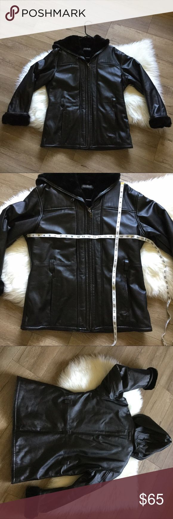Wilsons Black hooded leather jacket fux fur lining Genuine leather jacket from Wilson Leather. Size L, with additional measurements available in photos. Has faux fur lining inside whole jacket and even has a hood. Great condition no scuffs, scratches or cracks. Only flaw it's missing the belt, other than that it's great! Save 20% when bundled with any other item available in @teashopkids or @teashop. Wilsons Leather Jackets & Coats