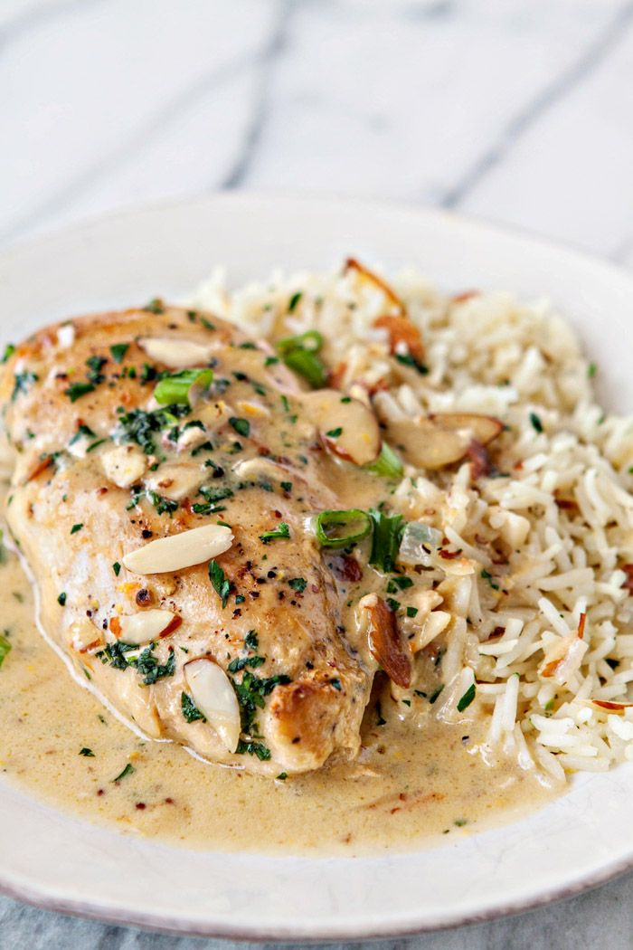 Creamy Orange Almond Chicken and Rice - In this Creamy Orange Almond Chicken and Rice, golden brown chicken breasts are smothered in a creamy orange almond sauce and served alongside an almond rice pilaf for a simple and comforting recipe during the colder days just prior to gorgeous, warm spring days. @fishernuts #thinkfisher