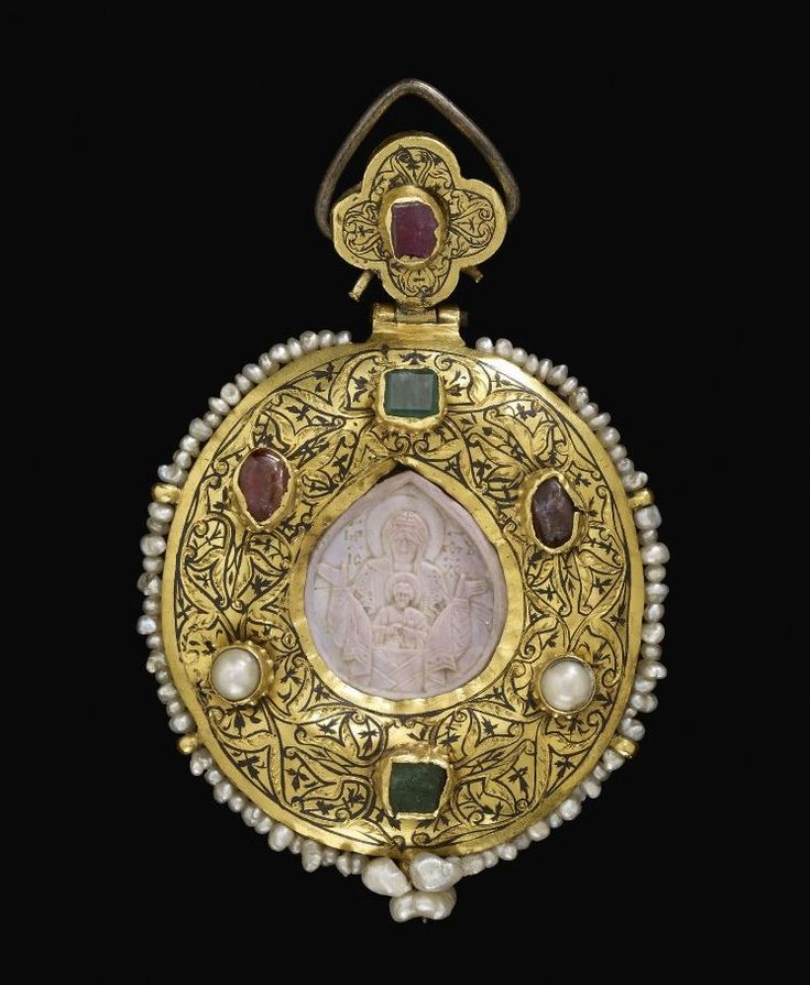 Pendant; gold; oval; convex on the front, with enamelled scroll decoration, and six settings containing two emeralds, two rubies and two pearls - 11thC-12thC (?;steatite) / 15thC-16thC (pendant).