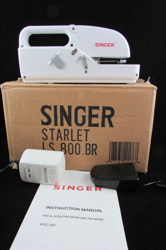 vintage singer handheld sewing machine