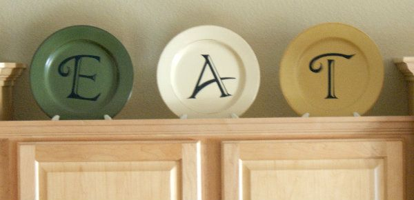 E-A-T in the Kitchen- Vinyl on Plates these would look great on my cabinets.