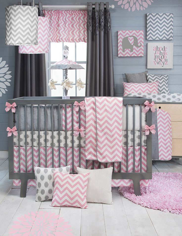 SO CUTE!Stylish pink chevron bedding now available for baby girls! Pink, grey and white are the perfect color combination for the ever popular chevron pattern. All prints are 100% cotton. White and gray velvets accent the hand-patched bumper and make soft decorative pillows. Bumper, quilt and rail guards are trimmed with silver piping. Super soft quilt backing eliminates the need for fill. Clean and contemporary bedding is easily accessorized with a wide selection of decorative wall art, fun…