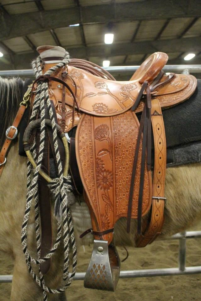 Made by Randy Jones. Stevensville, MT. Made for Kim. Sunflowers, faux stirrup leathers, light, wade, patch seat, roping saddle, pineapple stirrups, Kim's design, Ben Swanke tree