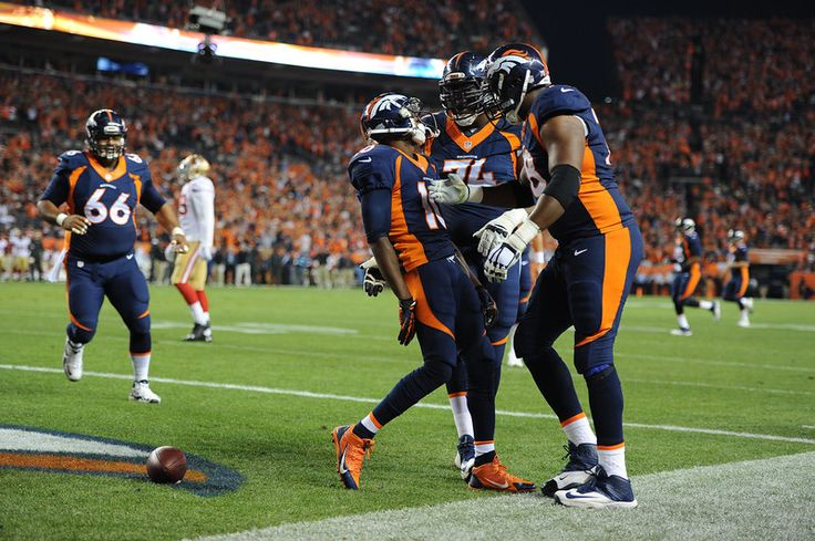 Emmanuel Sanders (10) of the Denver Broncos celebrates a touchdown in the end zone with Ryan Clady (78) of the Denver Broncos and Orlando Franklin (74) of the Denver Broncos. The Denver Broncos played the San Francisco 49ers at Sports Authority Field at Mile High in Denver on October 19, 2014. (Photo by Tim Rasmussen/The Denver Post)-- #ProFootballDenverBroncos