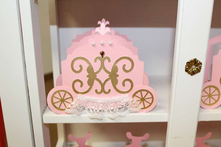 Pink carriage treat holders at a princess birthday party! See more party planning ideas at CatchMyParty.com!