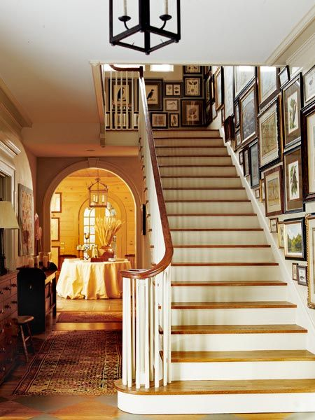 The redesigned front vestibule of this home now functions as a gallery space for the owner's collection of prints and antique maps. The arched entryway frames the new solarium. (Photo: Photo: Jeff McNamara; Designer: Mark Maresca)