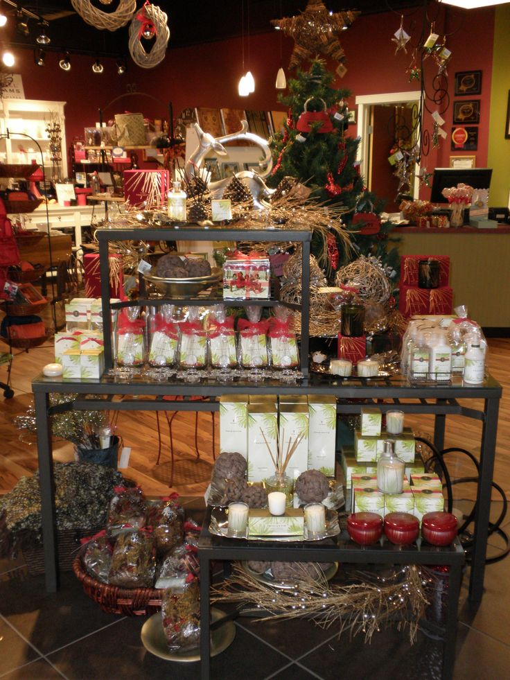 Rustic holiday scents and decor table visual for Retail shop display ideas