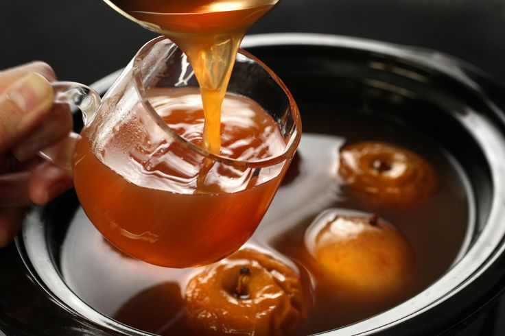 Spiked Wassail: Apple juice/cider, cran juice, dark brown sugar, cloves, allspice berries, cinnamon, apples, orange