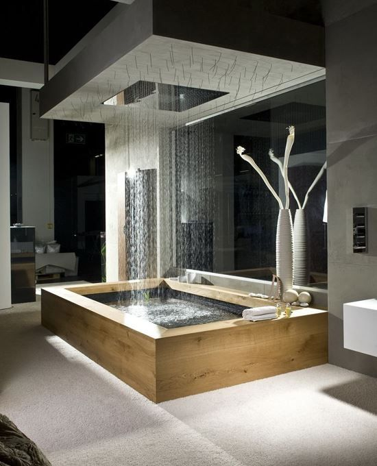 Wooden bath with overhead rain shower and natural elements. Modern bathroom.