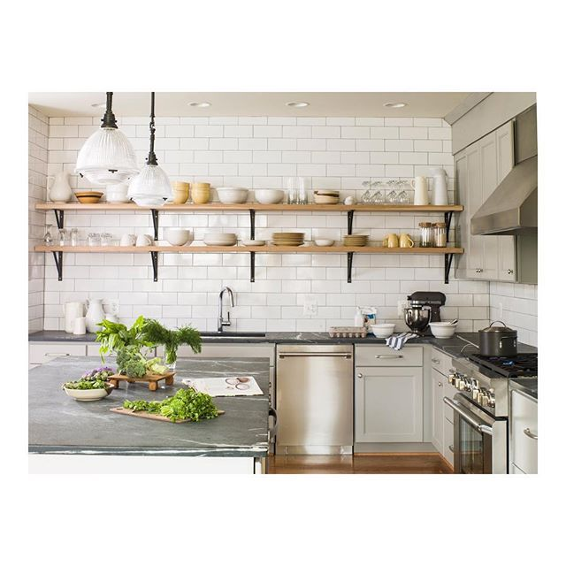 A Simple Practical Kitchen With A Mix Of Closed Upper Cabinets