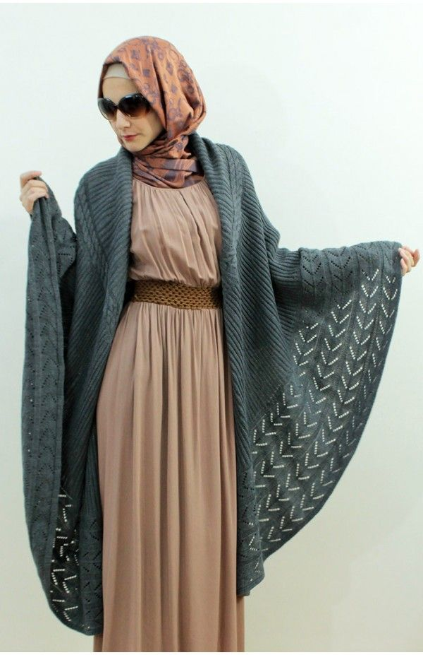 Norwegian blue sweater shawl drapes over maxi dress in complimentary shade of dusty rose