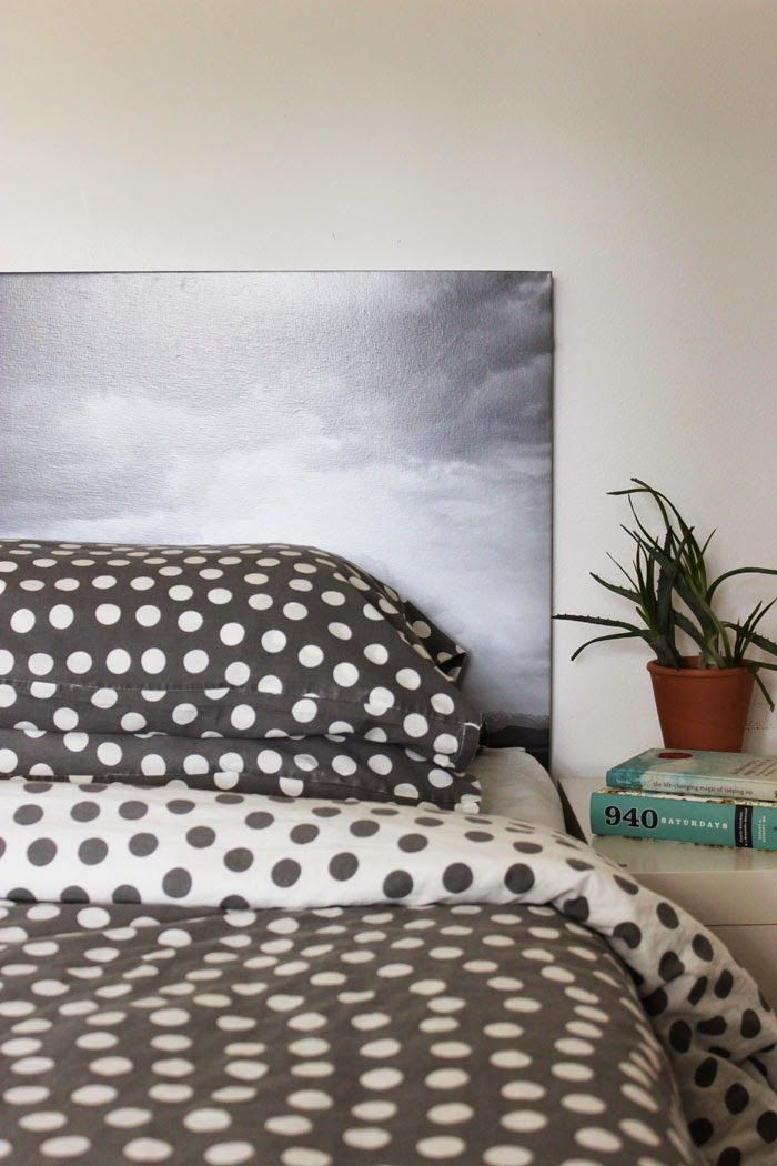 need a headboard? why not make a photo one!