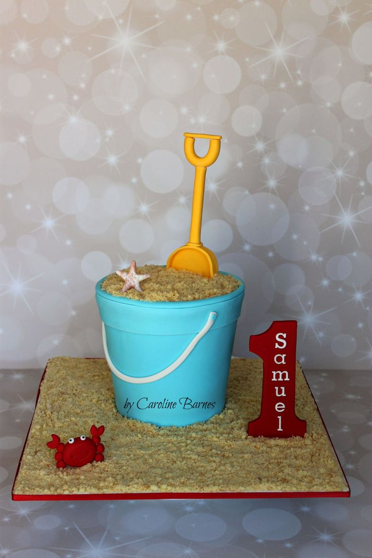 Bucket And Spade Cake Bucket and spade cake. With a carved bucket shape, fondant decorations and shortbread biscuit 'sand',...