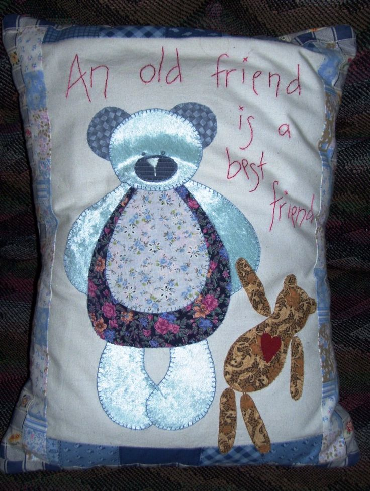 Patchwork pillow. Pieces were ironed on then hand stitched around.