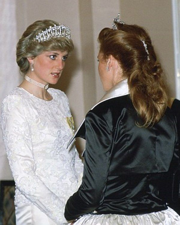 (L) Princess Diana and Sarah, Duchess of York were snapped chatting at Claridges Hotel in March 1987. The Princess of Wales chose a pearl choker and pearl earrings to go with the headpiece and white beaded gown. Royal Family Around the World: Princess Diana