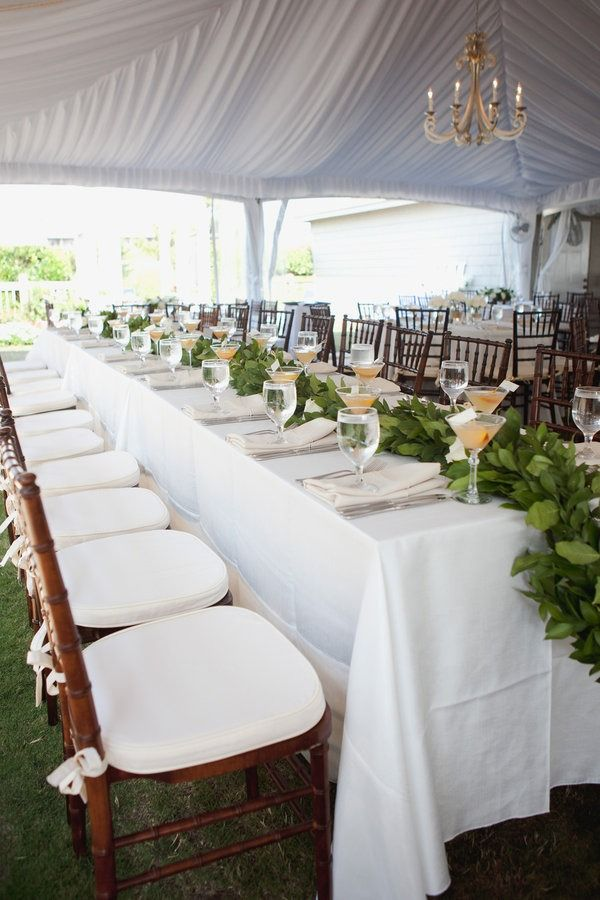 Something to think about... simple centerpiece idea: greenery along middle of long table. Photo by Morrissey Photo