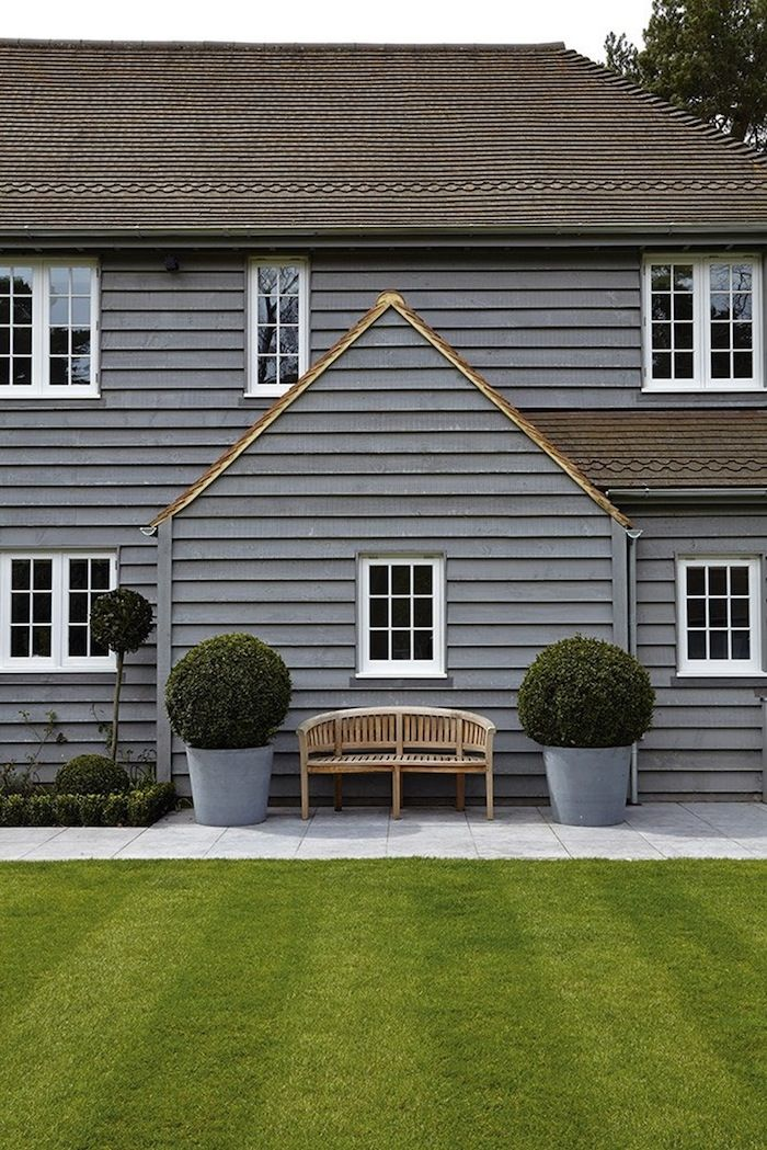 Make a house look welcoming with topiary trees.