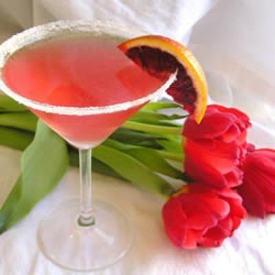 Cranberry Martini  1 (1.5 fluid ounce) jigger vodka  1/2 fluid ounce orange liqueur  1/2 fluid ounce dry vermouth  2 (1.5 fluid ounce) jiggers cranberry juice  1 cup ice