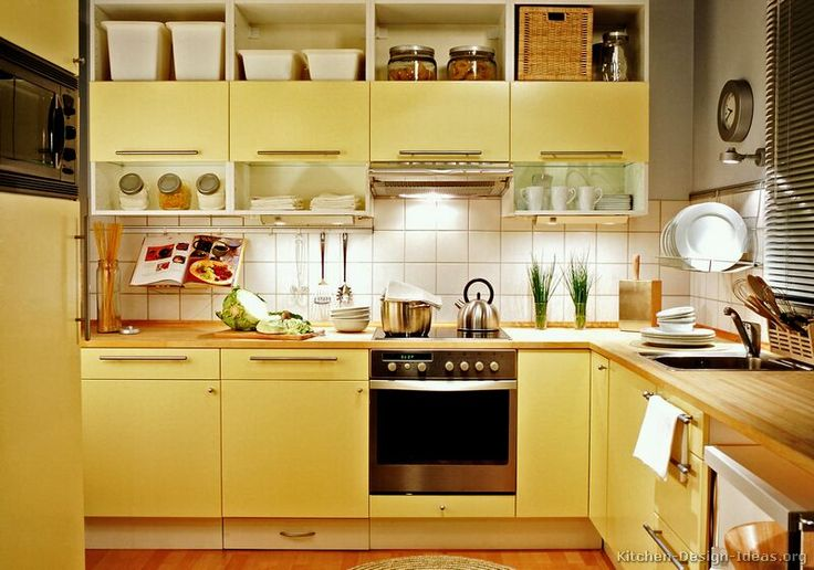 Modern yellow kitchen with butter-toned cabinets, butcher block countertops, and open shelves  (Kitchen-Design-Ideas.org)