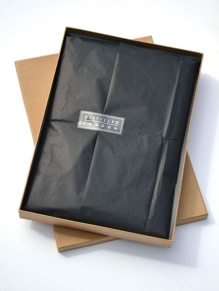 unbleached Kraft cardboard boxes, black tissue paper, with clear foiled label…
