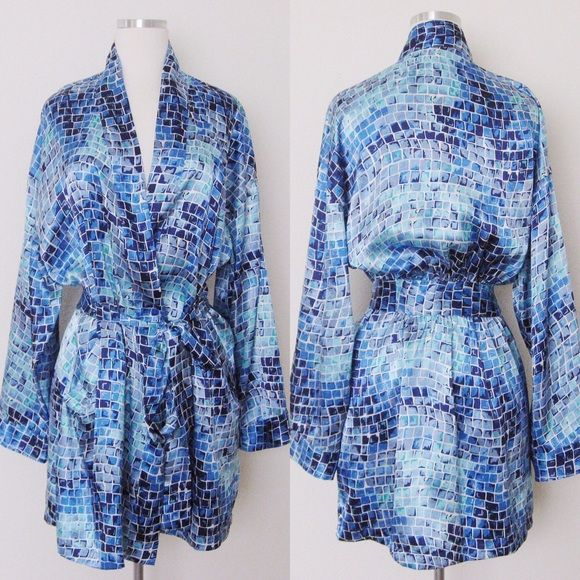 "Victoria's Secret Blue Satin Kimono Robe Victoria's Secret Blue Satin Kimono Robe. One size. Pre-owned in very good condition. No visible flaws or snugs. Side pockets. Materials: 100% Polyester Measurements: Width- 24"" (pit to pit) Length - 33"" (shoulder to hem) ❌SWAP❌TRADE ✔️15% OFF on BundlesMessage me if you have any questions. All sales are final. Thanks for looking! Victoria's Secret Intimates & Sleepwear Robes"
