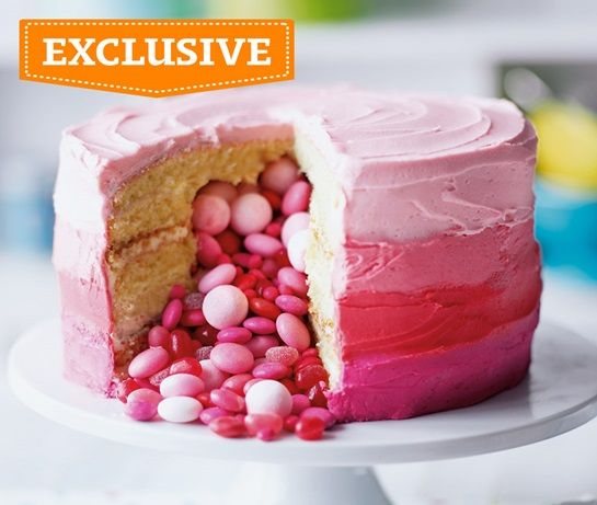 Layered cake with pink icing and pink sweets pouring out of the middle, exclusive to Asda Recipes