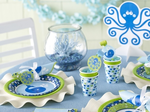 You'll love our whale themed baby shower! A beautiful new baby shower theme for little boys, our Ocean Preppy Boy party supplies are here!  Featuring friendly blue whale and octopus characters, an argyle pattern, and baby-friendly shades of blue and green, these are going to be very popular decorations!Besides all of the usual tableware, this pattern features unique decorations like a semi-customizable giant party banner, cupcake wrappers, and cone-shaped favor bags!The whale at the center…