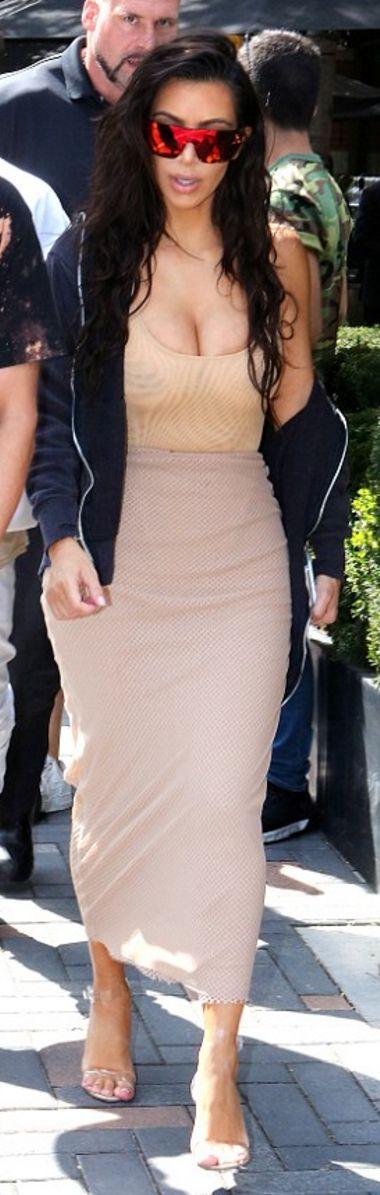Kim K: Sunglasses – Celine  Skirt – Laquan Smith  Shoes – Manolo Blahnik