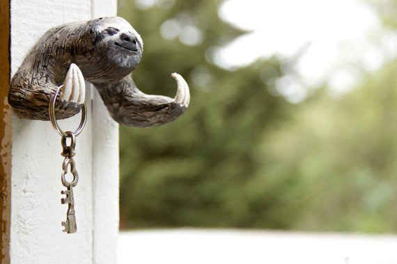 This sloth hook to hold the keys to your sloths. | 37 Sloth Items To Help You Live A Sloth Life