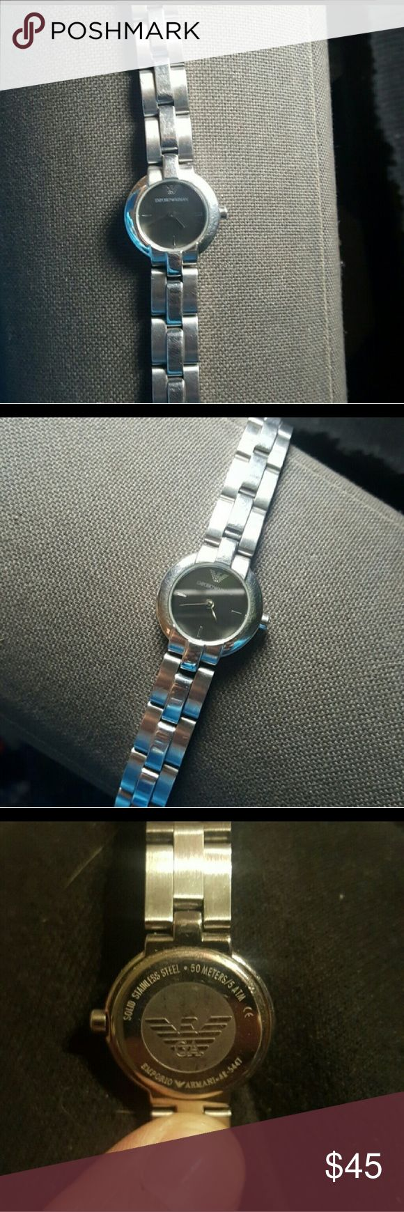EMPORIO ARMANI WATCH- AUTHENTIC Authentic Armani watch. Solid stainless steel. 50 meters/5ATM. Beautiful two tone silver. Barely worn even when battery worked. Its a very sharp looking watch. The glass plate is in excellent condition, barely any scratches, if any. The battery died but the watch definitely works. I would suggest a small to medium wrist. Links can be removed if needed or can always switch out the band for a new one. Price is firm. (Will add more photos) Emporio Armani…