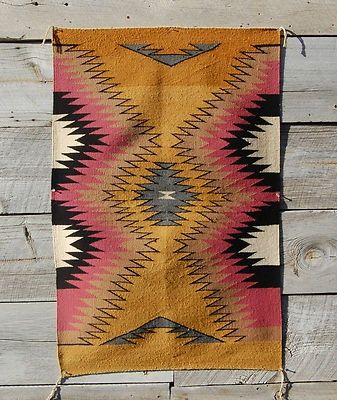 Bohemian tribal rug--under black pattern Indian chair.