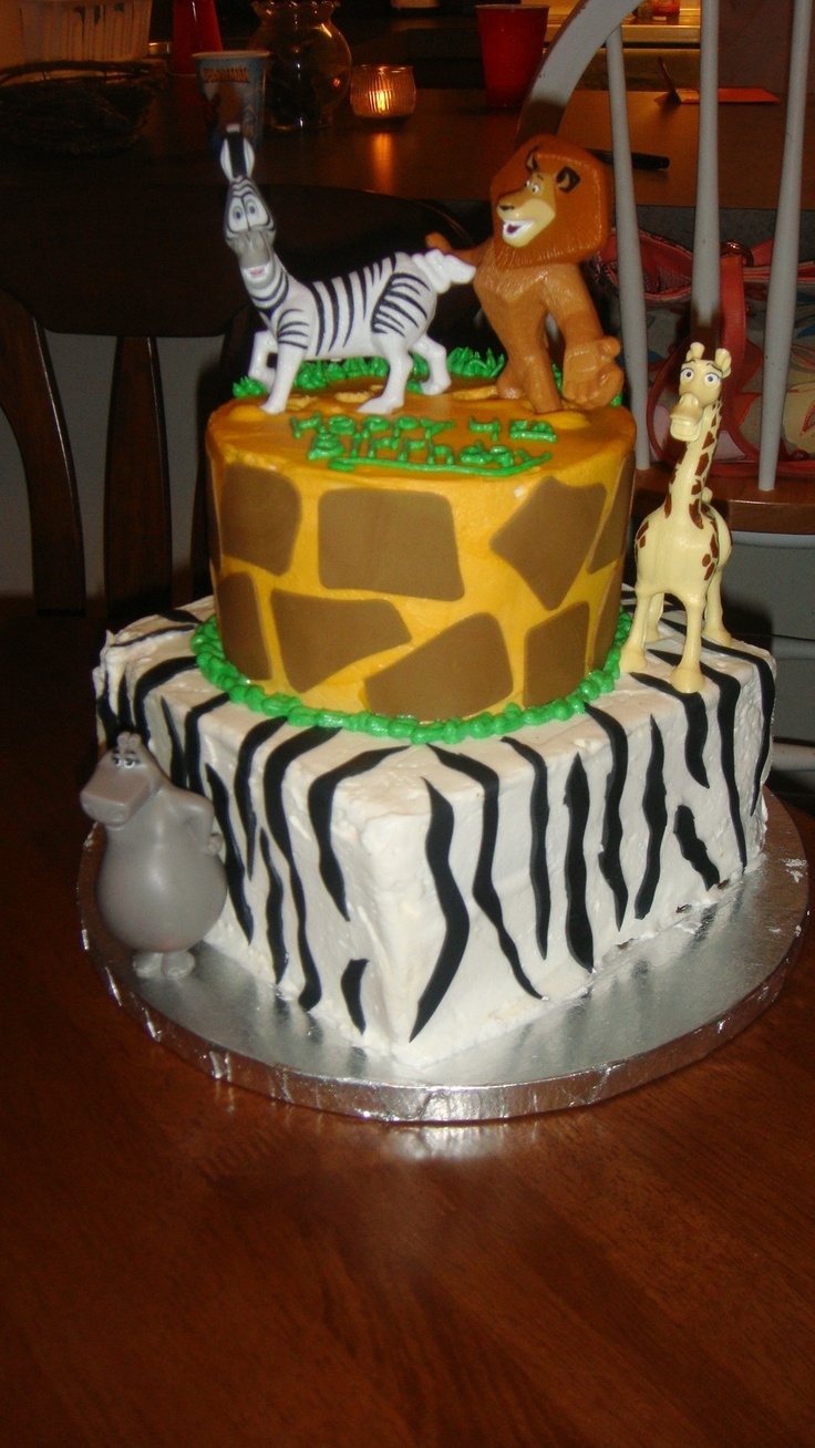 Madagascar Birthday Cake - Birthday cake for my nephews 4th birthday.  Zebra cake with bc frosting.  This picture was after the kids started attacking it.. haha.