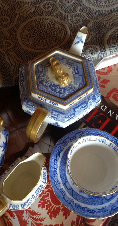 We'll take a cup of kindness yet for days of Auld Lang Syne...such beautiful Blue and White china with Gold Gilt!