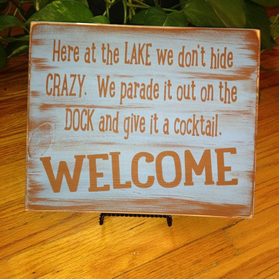 Here at the LAKE we dont hide CRAZY, we parade it out on the DOCK and give it a Cocktail! Welcome! Fun for the Lake house, the Cabin!! Cabin Gift Ideas….for Mothers Day, Fathers Day, Summer Cabin Fun for all…. Sizes Available 18 x 18 IN.  20x 20 IN.  Customize your colors - Id be happy to Change things up, Send me a message and lets Personalize this for you!  (1st Picture SHOWN Brown letter with Light Blue Background) (2nd Picture Shown White Letter with RED Background) (3rd Picture Shown…
