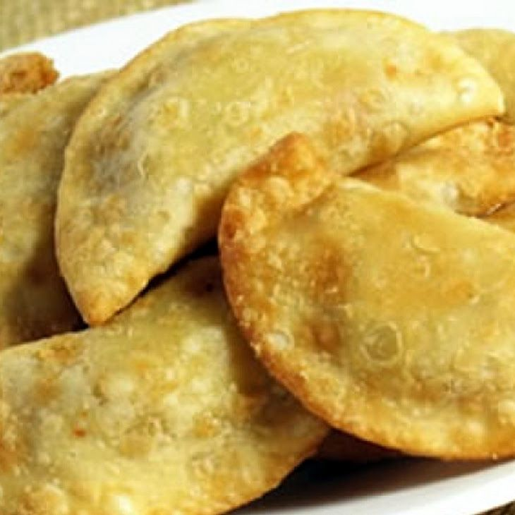 Party Empanadas -   Ingredients:      1 lb beef round (ground)     1 lb chorizo sausage     2 onions     4 garlic cloves     4 jalapeno peppers     8 ozs monterey jack cheese     8 ozs corn (frozen)     34 ozs puff pastry (frozen)