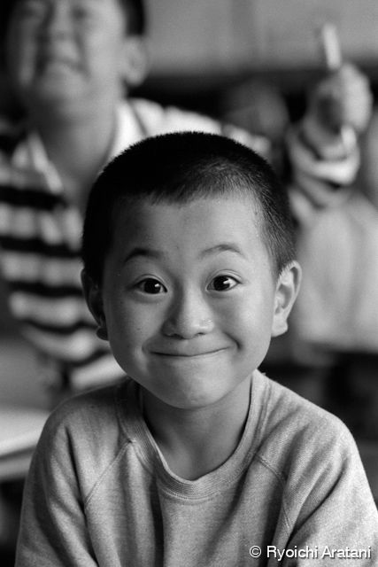 "from 木造校舎の子供たち / ""Children of wooden Schoolbuilding"" series by Ryoichi Aratani. Japan. Smiling boy."