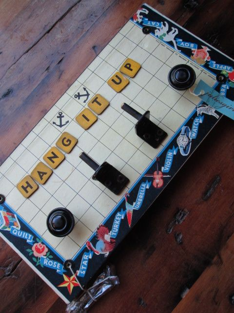 My crazy kids hanger, created with weird hooks and vintage game board pieces