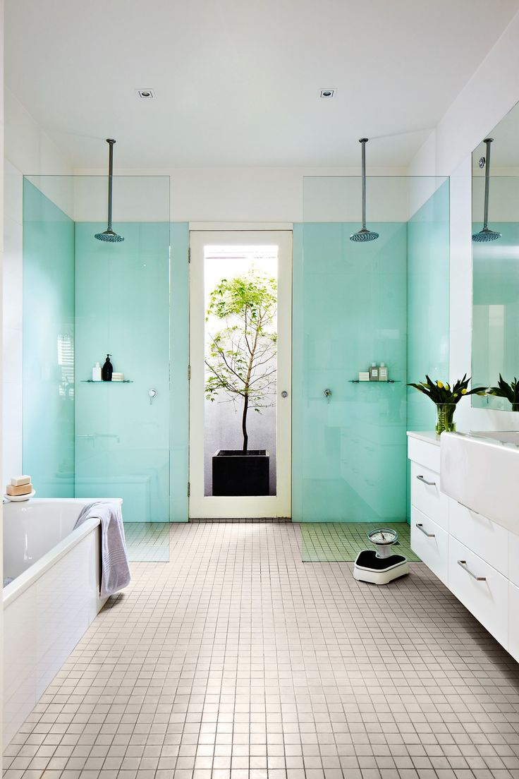 His and hers walk-in showers are separated by a glass door that leads to a walled side passage – a neat solution for letting steam out of the bathroom.
