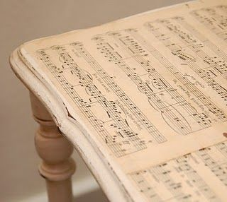 MUSIC: would make a nice piano bench or sweet table. Modge  Podge sheet music on wood table.