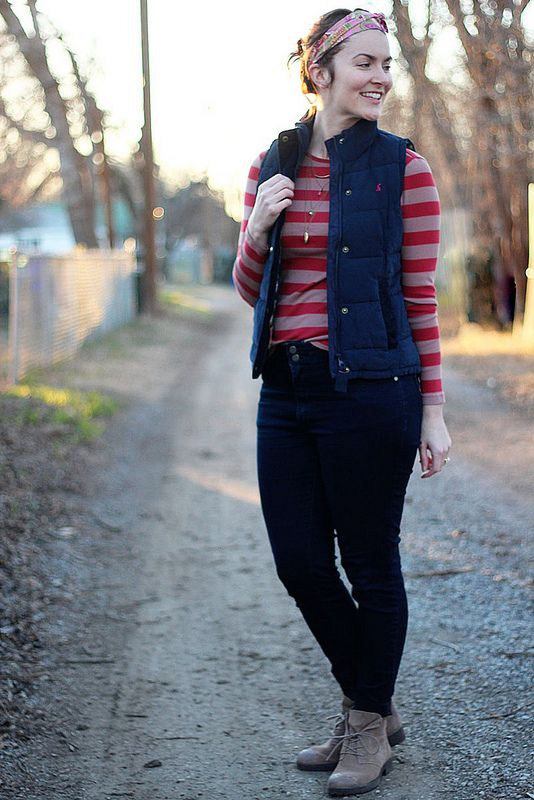 pink striped tee with blue puff vest and headband